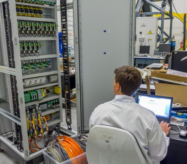 View of an engineer working on the electronic system of an instrument