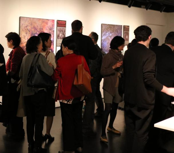 "Visitors to the inauguration of the exhibition ""100 Square Moons"" at the Cervantes Institute in Tokio"