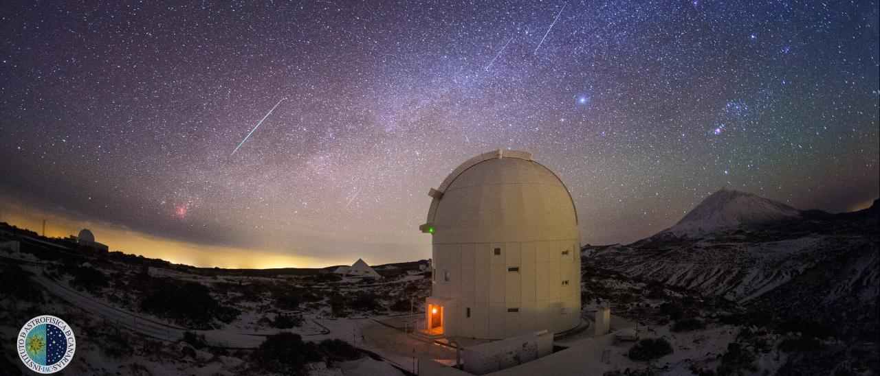 Image of several lines of Geminides observed from the Teide Observatory in the early morning of 14/12/2013. The telescope in the foreground is the OGS (ESA) and above the Teide is the constellation of Orion. Credit: J.C. Casado (StarryEarth).
