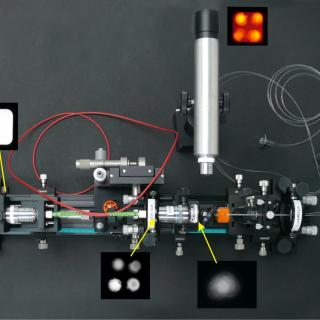 Setup in the laboratory for the characterization of optical fibers. View of a setup with several optical components and optical fibers on a laboratory table