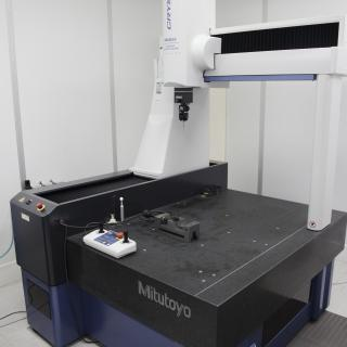 View of a three-coordinate measuring machine in the laboratory. Granite table with a gantry machine with a meter sensor