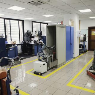 General view of the Instrument Maintenance Workshop with several work benches, cabinets and several machines under repair